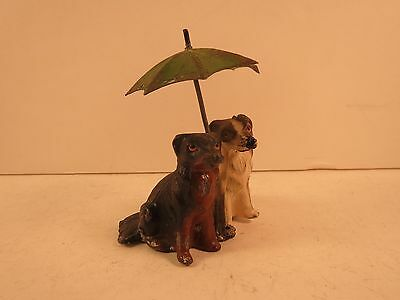Vintage metal dogs under an umbrella, made in Germany