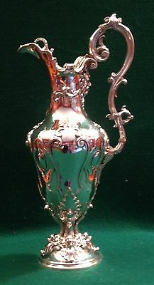 Very large Victorian silver plated wine jug with dolphins circa 1880