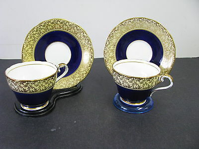2 VINTAGE AYNSLEY MATCHING CUPS & SAUCERS IN COBALT BLUE GOING TO A GOLD  & N/R