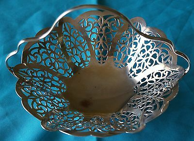 This is a Love Lace Design Silver Plated Footed Basket With a  Nice Handle.