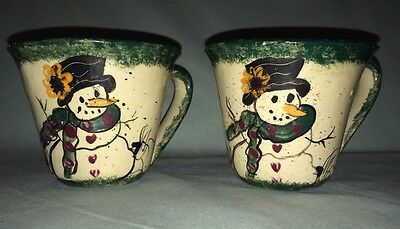 GAIL MILLER POTTERY CUPS, GREEN AND CREAM WITH DROLL HAND-PAINTED SNOWMEN