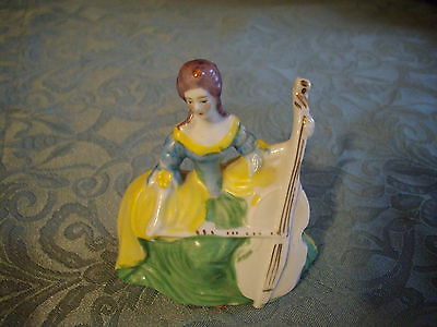 Vintage miniature figurine woman  playing  cello  made  in Japan