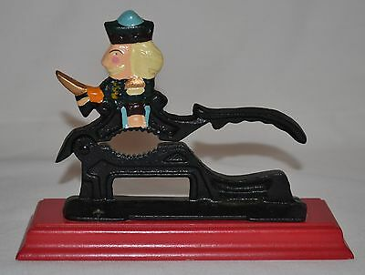Vintage Cast Iron Nut Cracker Christmas Soldier on Red Wood Base Hand Painted