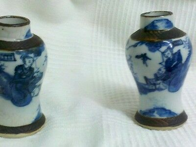Antique pair of blue and white crackleware chinese vases