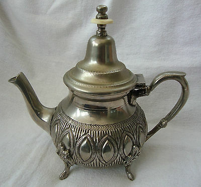 A VINTAGE  FRENCH EMBOSED SILVER PLATED TEAPOT TEA POT ON FOUR CLAW FEET