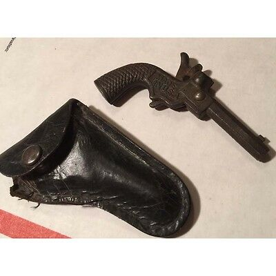 Original vintage/antique small CAST IRON BIG CHIEF CAP GUN with Leather Holster