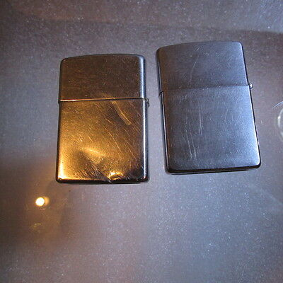 two Zippo lighters one is dented