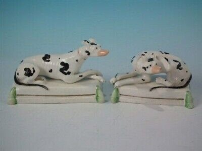 Pair Rare Staffordshire recumbent whippets on cushions