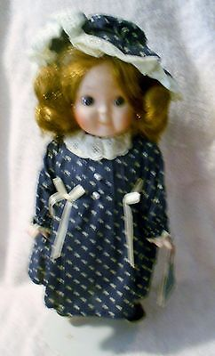 """Victoria Ashlea Musical plays """"It's a small world"""" porcelain doll from  Germany"""