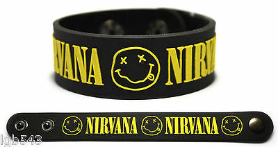 MIP-NIRVANA Black Rubber Wristband/Yellow Print and logos with adjustable snaps