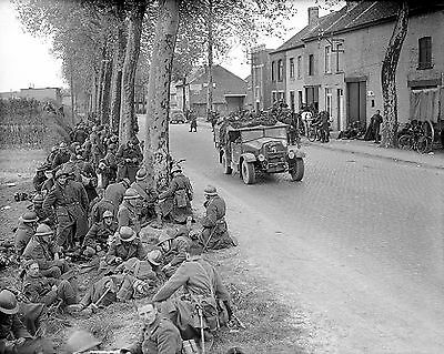 Photo-A group of Belgian troops resting by the roadside in Louvain 14 May 1940