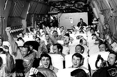 Freed Prisoners of Vietnam War Celebrate as C-141A Aircraft Lifts Off Hanoi 1973