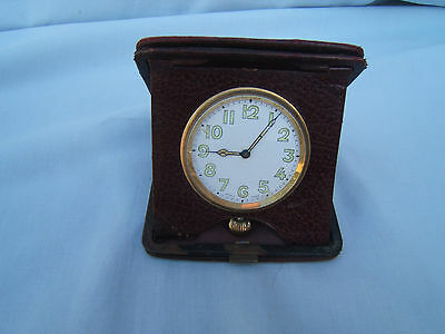 Swiss vintage travel clock in Red leather case working great condition    Ref 1