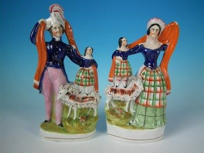 Pair Staffordshire Royal family with goat figures