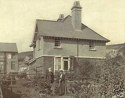 Older Couple Posing For The Camera In Front Of House & Original Antique Photo