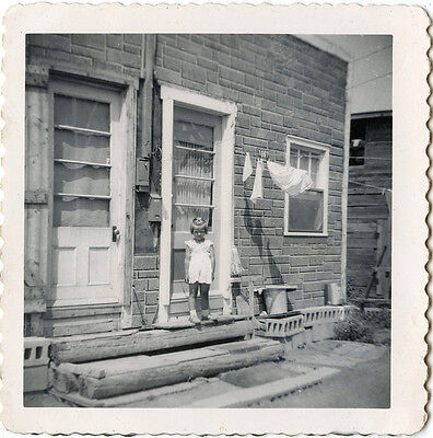 Little Girl Posing For The Camera In Front Of House & Vintage Snapshot Photo