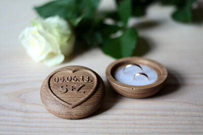 Personalized wooden wedding ring box with carved initials and date, oak wood.