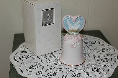 "Avon ....1995....porcelain  Bell... ""love's  Beginnings""   W /box"