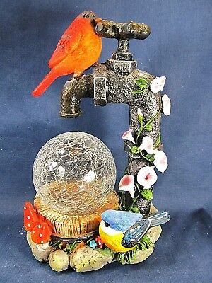 Red Bird on a Water Faucet w/ glass globe and LED light yard or patio decor