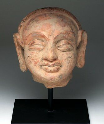 Lifesize Kushan Period Pottery Portrait Head of a Woman, 2nd/3rd century AD.