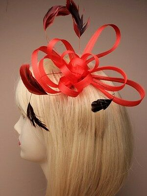 Large coloured coiled net and feather fascinator on comb.colour  assortment