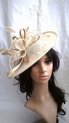NEW IVORY WITH GOLD SINAMAY & FEATHER FASCINATOR HAT.Shaped saucer disc,Wedding.