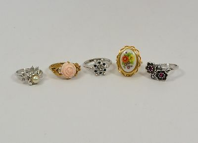 Avon Rings - 3  in White and 2 in Yellow
