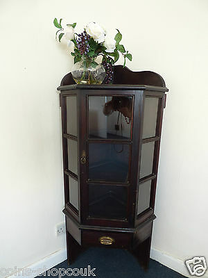 Antique corner cabinet with one drawer,three shelves