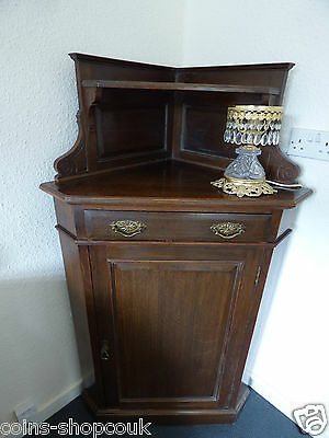 Antique corner cabinet with one drawer,two shelves lovely condition