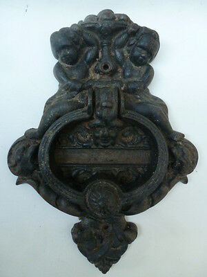 Old Cast Iron Door Knocker with Cherubs and Relief Mask 9 inches