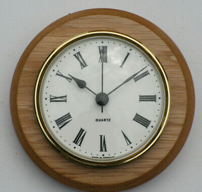 Oak Clock Suitable for Caravans, Motorhomes White Roman dial with brass bezel.