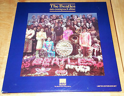 The Beatles CD HMV Sgt. Pepper's #014025 with mint cut-outs, booklet & badge