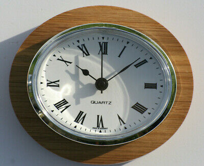 Oval Clock Suitable for Caravans, Motorhomes and Boats. Roman with silver bezel