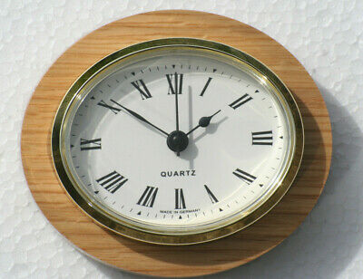 Oval Clock Suitable for Caravans, Motorhomes and Boats. Roman with Brass bezel