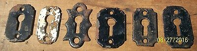 6 - Antique Key Hole Escutcheons, Original Black Paint, One Has White Paint.