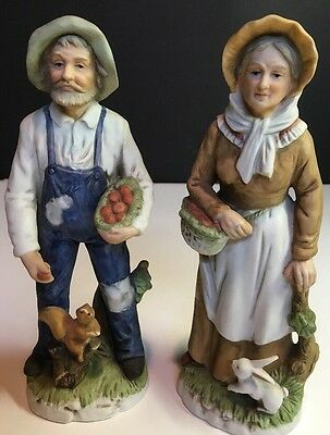 Homco 1409 porcelain figurines Man with Squirrel/ Woman with Rabbit