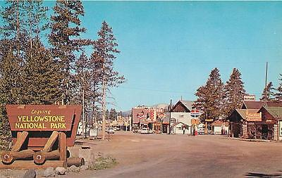 WEST YELLOWSTONE, Montana MT   Leaving Yellowstone Street Scene  1950s  Postcard
