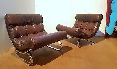 Pair Of Mid Century Counter lever Chrome And Leather Chairs