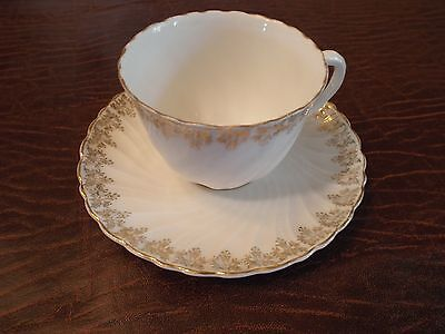 KPM Germany Cup and Saucer white with Gold Flowers on Rim