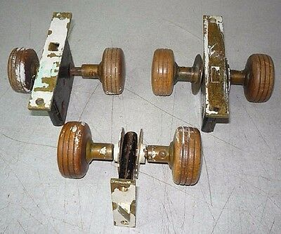 3 sets of Antique wood door knobs, escutcheons, and locks. Heavy dense wood knob