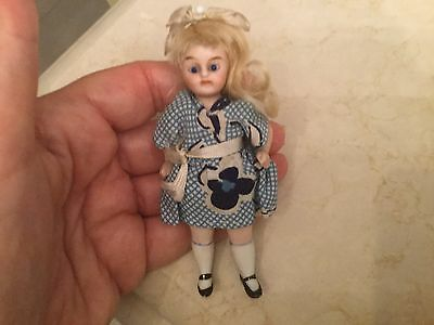 Antique miniature porcelain doll with glass eyes