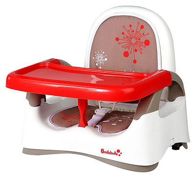 Brand new Badabulle booster seat in red from 6 to 36 months with brown cushion