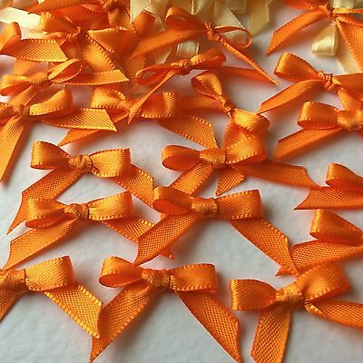 30 Pretty orange 6mm Ribbon bows for card making/scrap booking -charity