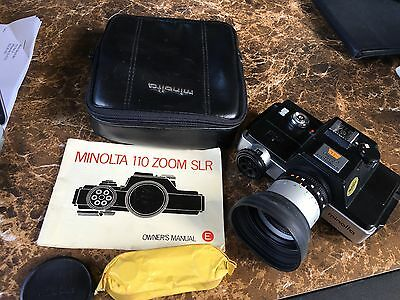 Vintage Minolta 110 Zoom SLR Camera with Manual, Case, and a Roll of Film
