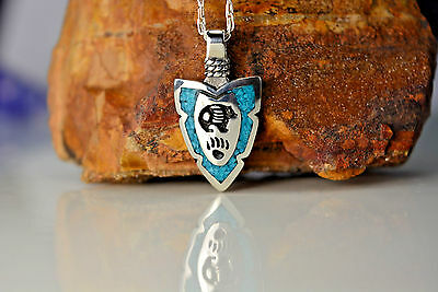 Sterling silver Small Arrowhead pendant w/ a Bear & Bear Paw w/ Turquoise inlay