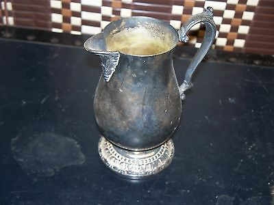 WM Rogers Silver Plated Creamer And Spreader knife