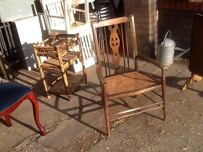 old dark Wooden  kitchen armchair with rattan upholstered seat