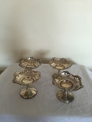 A Set Of 4 Pierced Solid Silver Bon Bon Dishes . Birmingham 1925. (Weighted)
