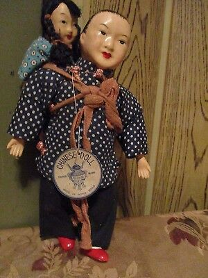 Vintage Chinese Doll Carrying Child.  Tripod Mark, Made in Hong Kong