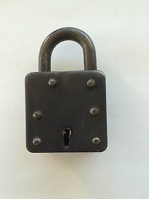 Ancient padlock with one key in functional condition